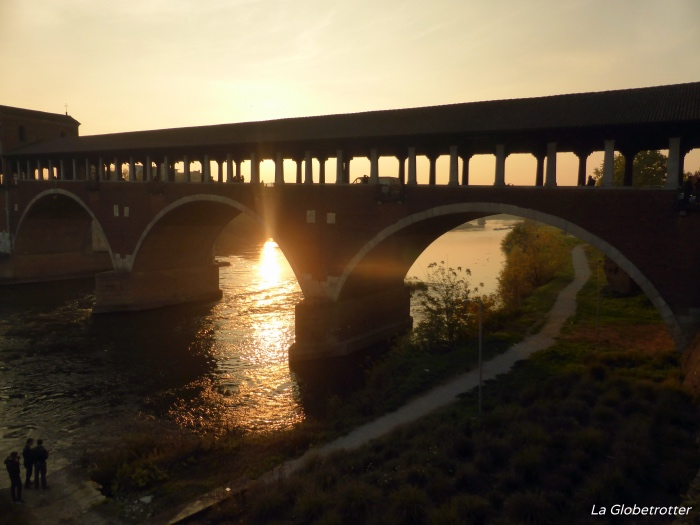 "alt=""il-ponte-coperto-al-tramonto"""